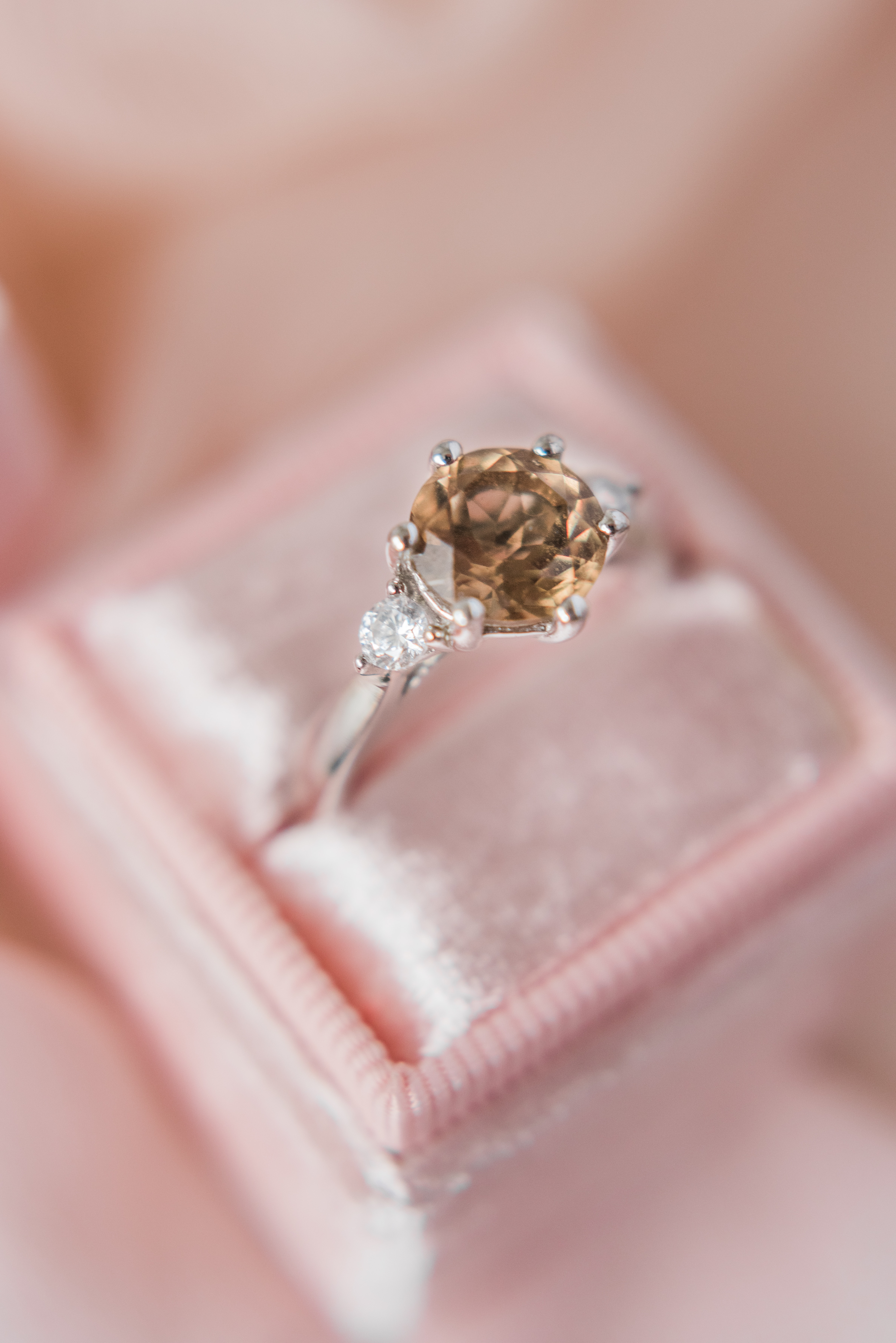 An engagement ring featuring natural diamonds